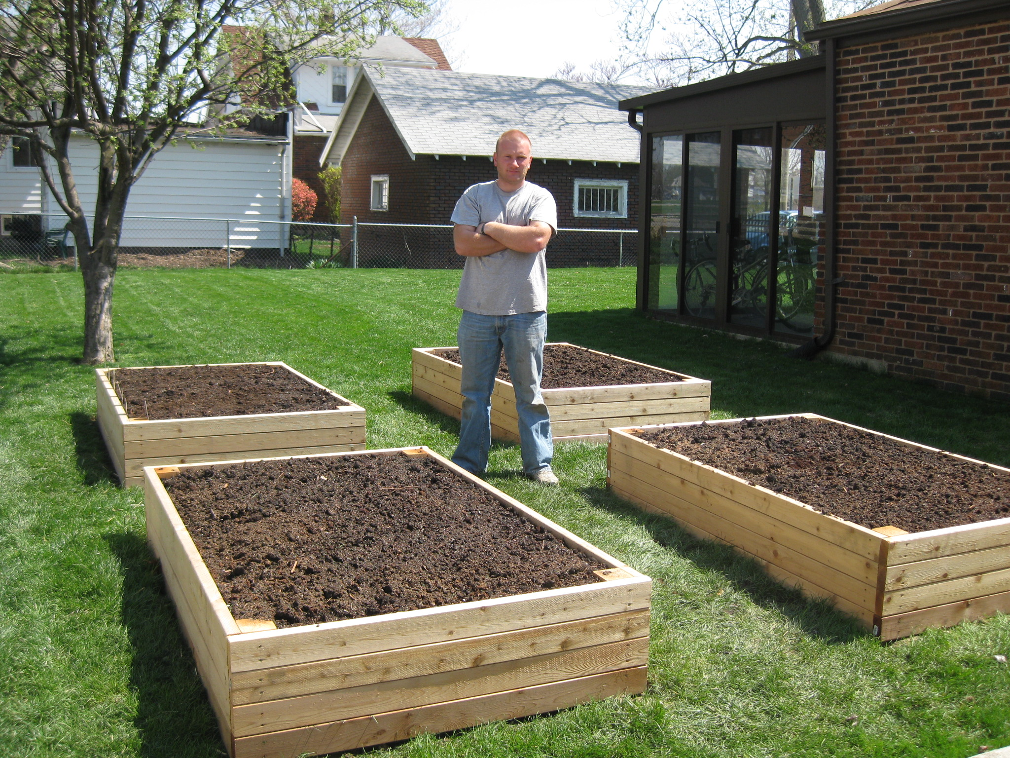 Superiority of the raised garden beds over row gardening