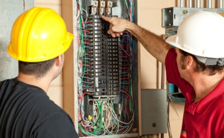 Professional Electricians checking the Electrical Panel