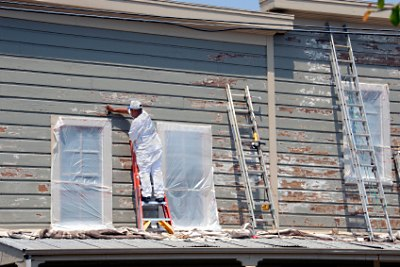 Scrubing the peeling and lose paint.