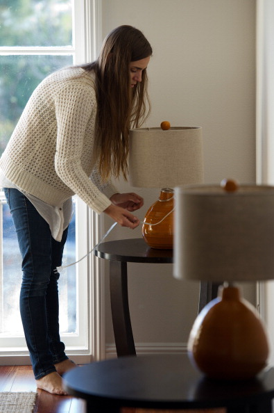 Home Stager Adjusting a Lamp
