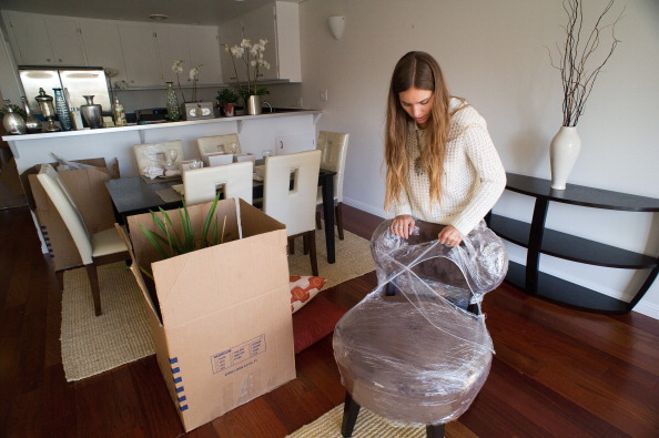 Home Stager Unpacking a Chair